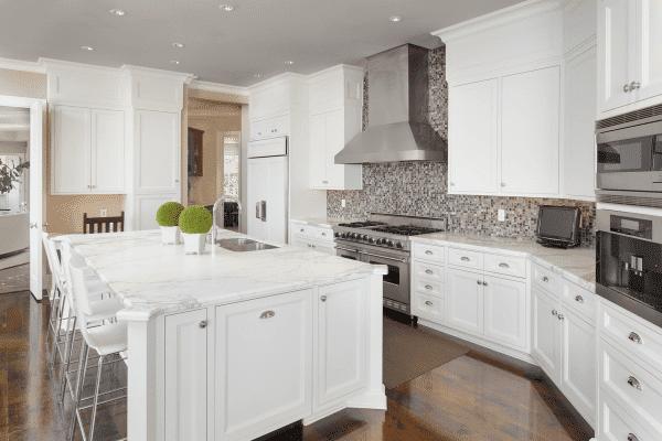modern white kitchen with tile mosaic backsplash